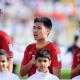 Đức Huy cùng đồng đội trong nghi thức chào cờ đầu trận Việt Nam - Iran tại Asian Cup.