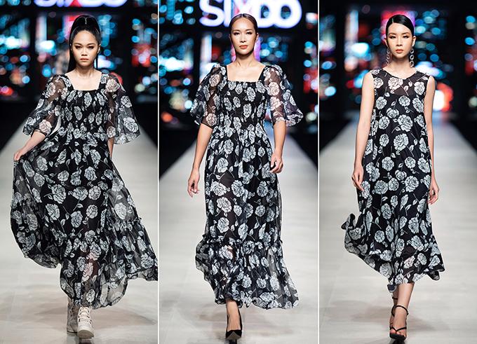 Váy dạo phố mùa thu thiết kế trên chất liều mềm mại, hoạ tiết uyển chuyển với cách phối hợp sắc đen trắng hoà quyện.
